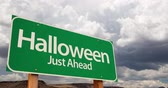 4K Time-lapse Halloween Just Ahead Green Road Sign and Stormy Cumulus Clouds and Rain. Wideo