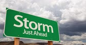 4K Time-lapse Storm Green Road Sign and Stormy Cumulus Clouds and Rain.