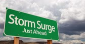 4K Time-lapse Storm Surge Green Road Sign and Stormy Cumulus Clouds and Rain. Wideo