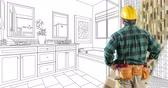 4k Looping Cinemagraph of Contractor in Hard Hat Facing Drawing of Bathroom Design Transitioning to Photo.
