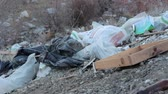 aterro : Abandoned piles of waste and debris. Open dumps. Abandoned piles of waste and debris Stock Footage
