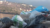 hazardous waste : Bags of rubbish in an urban environment. Open dumps. Abandoned piles of waste and debris. The illegal deposit of waste dumped or tipped on a site with no license to accept waste