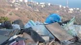 atık : Illegal Dumping and Landfill. Construction and demolition waste. Abandoned piles of waste and debris. Discarded material (blocks, bricks, concrete, glass, plastics, steel, wood) Stok Video