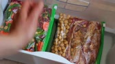 reçete : Freezer meals for a month. Packing in Ziploc bags Stok Video