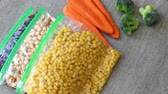 bakkaliye : Bags of Frozen Vegetables. To prepare, blanch and freeze garden vegetables, berries, and fruit for winter use Stok Video