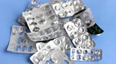 наркомания : Empty used prescription medication tablet blister packs Стоковые видеозаписи