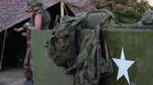 arma : Male and female American soldiers. US military field camp, Military Backpacks, US Army star. American armored personnel carrier used by the Allies during World War II and in the Cold War