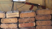 calibre : Wooden boxes of weapons. Assault rifle. Boxes With Weapons And Ammunition In A Military Camp.