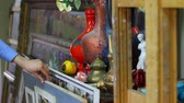 экспонат : Shopping in antique shop. Person Looking At Old Antiques In Antique Shop. Painting