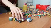 görüntüler : Children moulding animal figurines from multicolour clay in playroom Stok Video