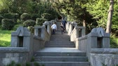 kameny : Stone Stairs In The Old Park. A man and two boys go up the old stone stairs