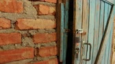 obora : Old Wooden Door & Open Padlock