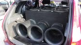 decibels : Sub woofers close up. Bass SOUND WAVES. Loudest Sound System. Subwoofers are installed in the trunk or back seat space
