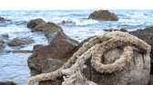 kablolar : Old Braided Rope. Marine rope on the beach