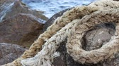 mooring : Braided rope. Marine rope on the beach Stock Footage