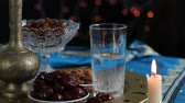 crockery : The pre-dawn meal of Suhur. Water and dates. Fasting in the Holy Muslim month of Ramadan