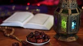 brunei : Quran, dates, rosary and oriental lantern lamp. A fast-breaking feast (Iftar). Fasting the month of Ramadan Stock Footage