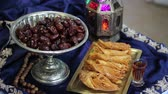 ele almak : Colored lantern with dates food and Middle Eastern desserts. Muslim Holiday Traditions Stok Video