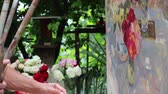 džbán : Artist Working On Painting In Outdoors Studio. Still life with flowers in the garden. A work of art