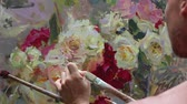 vytvořit : Close up of mans hand painting still life picture on canvas in art studio. Impressionism. Professional work. Piece of art Dostupné videozáznamy