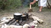 csapkod : Camp in the forest. Pans on the fire. A vacation in a camp, tent, or camper