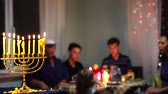Happy Jewish Family Celebrates Hanukkah. Festival of Lights. Israel people. The hanukkah menorah Dostupné videozáznamy