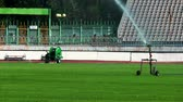 distribuidor : watering in a football pitch