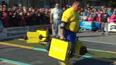 snatch : MARIUPOL, UKRAINE - OCTOBER 10, 2015: Match meeting strongmen Ukraine and Europe. The athlete carries iron suitcases weighing 150 kg each