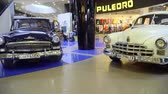 exotikou : Mariupol, Ukraine - October 29, 2016: Exhibition of vintage cars in the mall. Soviet retro cars. GAZ-12 ZIM and GAZ 21 Volga.