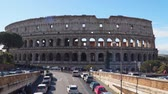 flavian : Rome, Italy - March 21, 2018: Majestic ancient Colosseum in Rome against blue sky