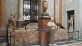 экспонат : Rome, Italy - March 21, 2018: Bust Pope VII and Two bronze peacocks in the Vatican Museums, Braccio Nuovo
