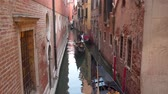 veslo : Venice, Italy - March 23, 2018: Gondola on the narrow canals of Venice