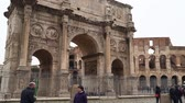 coliseum : Rome, Italy - March 21, 2018: Historic Arch of Constantine is a triumphal arch in Rome