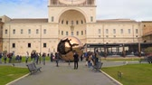 внутри : Rome, Italy - March 22, 2018: The Metal globe statue in the courtyard of the pine cone in Vatican Museums. .