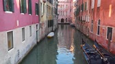 Canals of Venice. Gondolas near buildings on the bank of the canal
