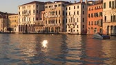gondoliere : Boat sailing along the Grand Canal at sunset. Venice, Italy.