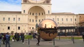 внутри : Rome, Vatican city- March 22, 2018: The Metal globe statue in the courtyard of pine cone.