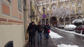 Tourists on the streets of Budapest. On the sidewalks snow