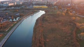 waterway : River in the city, autumn trees on the shore. Birds eye view. Stock Footage