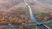 sauvage : River and bridge among the autumn fields. Aerial video Vidéos Libres De Droits