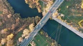 ストリート : Traffic on the bridge over a small river. Video shot with a birds-eye view. Autumn.