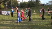 MARIUPOL, UKRAINE - SEPTEMBER 29, 2018: Trainer with young athletes are training outdoors. With the free input.