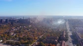 Smog over the city. Environmental pollution. Smoke from the metallurgical plant on the streets. Shooting drone