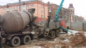 MARIUPOL, UKRAINE - December 29, 2018: Concrete loading. Auto Concrete Mixer and Feeding Concrete
