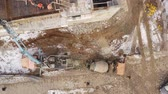 negócio : Aerial view. Auto Concrete Mixer and Concrete Feeding Concrete at Construction Site. Peoples faces are not visible