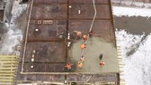 vasalás : Construction site. Builders poured concrete on the roof of the building. Aerial view