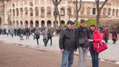 kolosseum : Rome, Italy - March 22, 2018: Tourists near the Colosseum in Rome Stock Footage