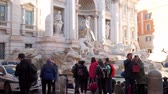 bilinen : Rome, Italy - March 22, 2018: Tourists near the Trevi Fountain in Rome Italy