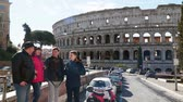 Rome, Italy - March 22, 2018: Family of tourists near the Colosseum in Rome