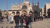 Venice, Italy - March 23, 2018: Family of tourists in St. Petersburg Marks Square in Venice